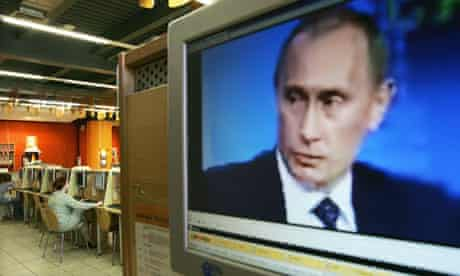 Russian president Vladimir Putin on a computer screen in an internet cafe in Moscow