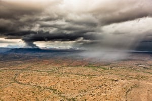 rift valley from above: Thunderstorms approaching near Desert Rose, Northern Kenya
