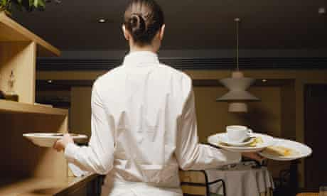 Waitress with dirty plates