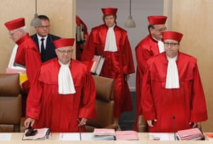 President of the German Constitutional Court Andreas Vosskuhle (R) arrives with other judges for the hearing on the European Stability Mechanism (ESM) and the fiscal pact in Karlsruhe July 10, 2012.