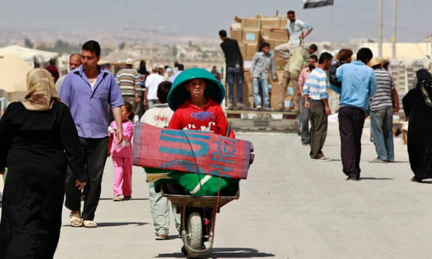 Syrian refugees go about their daily lives at the Zaatari refugee camp.