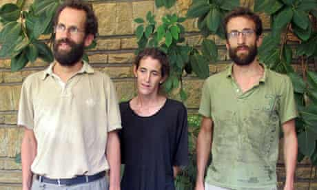 Former French hostages Tanguy Moulin-Fournier, left, his wife and brother