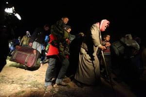 Zaatari refugee camp: Syrian Refugees Cross In To Jordan En Route To Zaatari Camp