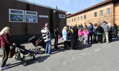 Parents and children queue outside Morriston Hospital in Swansea