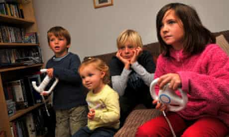 Children playing on Wii computer game