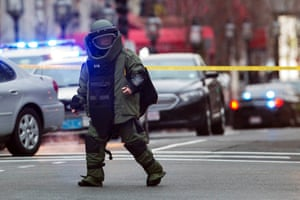 A law enforcement bomb technician walks away after preparing the controlled detonation of a suspicious object during a search for a suspect in the Boston Marathon bombing, in Watertown, Massachusetts April 19, 2013.
