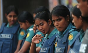 Bangladeshi police women on alert during a nationwide strike called by the Bangladesh Nationalist Party (BNP) led party alliance in Dhaka.