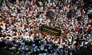 At Yaeway cemetery in Rangoon, Burma, people carry a coffin during the funeral for victims of a fire. Thousands of Muslims attended the funeral for the 13 victims of the fire that broke out in a dormitory of an Islamic school. The fire was caused by an electrical fault.