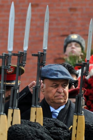 Yemeni President Abdrabuh Mansur Hadi, who is on an official visit to Russia, watches an honour guard's parade after a wreath laying ceremony at the Tomb of the Unknown Soldier in Moscow.
