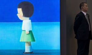 A security guard stands next to 'International Blue' by Chinese artist Liu Ye, 1964, on display ahead of the Sotheby's Spring sale 2013 in Hong Kong.