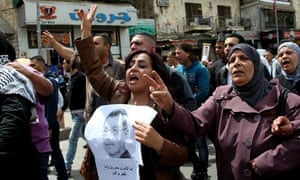 Palestinians protest against the death Maysara Abu Hamdiyeh, in the West Bank city of Nablus.