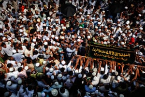 24 hours in pictures: Rangoon, Burma: People carry a coffin during a funeral for the victims of a