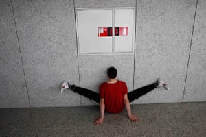 24 hours in pictures: Madrid, Spain: A dancer stretches before taking part in an audition for Dan