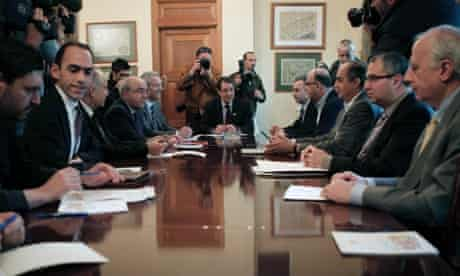 Cyprus' new finance minister Haris Georgiades, second from left, in a meeting ahead of the country's bailout.