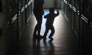 An autistic boy and his mother are silhouetted outside a classroomin at herapy centre for autism in Nanning, China. Autism experts estimate that there are about 1.5 million autistic children in China.
