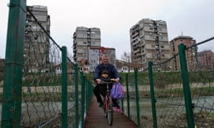 A Kosovo Albanian man rides across a makeshift bridge that separates the ethnically divided northern Kosovo town of Mitrovica. The leaders of Serbia and Kosovo are in negotiations over on one of the most important issues dividing them, as Serbia tries to meet conditions for eventual membership of the EU.