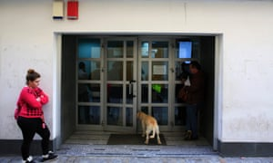 Serbia might want to join the EU, but things aren't that rosy in Spain as people and a dog stand at a doorway of a government-run employment office in the Andalusian capital of Seville. Spain has 5.04 million people out of work, data from the Labour Ministry showed on today.