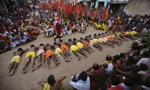 Devotees roll on hot sand during the beginning of the Danda festival or the festival of self-punishments at Kulagarh in the Ganjam district, Orissa, India. Surprise, surprise, only males participate in the 21-day long festival, which began today.