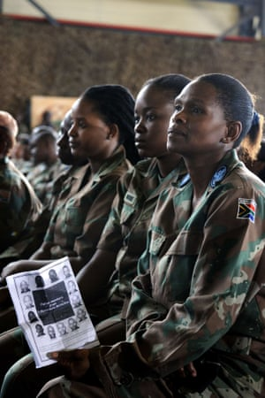 South African soldiers attend a memorial service at the Swartzkop Air Force Base in Pretoria for the South African soldiers who died during a battle with rebels in the Central African Republic. The thirteen soldiers were killed on March 23, on the outskirts of Bangui and twenty seven others were wounded.