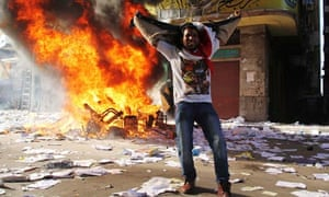 Muslim Brotherhood's Freedom and Justice Party office burns in Alexandria, protester