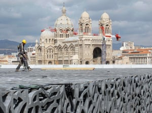A worker walks on the roof of the Museum of Civilizations from Europe and the Mediterranean (MuCEM) during a visit of France's Industrial Recovery Minister Arnaud Montebourg in Marseille, France.