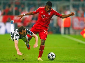 Juventus' Stephan Lichtsteiner (L) fights for the ball with Bayern Munich's David Alaba during their Champions League quarter-final first leg soccer match in Munich, Germany.