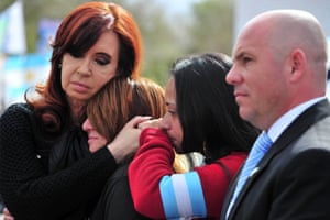 Argentine President Cristina Fernandez de Kirchner (L) consoles relatives of soldiers killed in the 1982 Falklands War with Britain, during the commemoration of the 31st anniversary of the conflict in Puerto Madryn, province of Chubut. Photograph: Handout/AFP/Getty Images