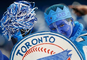 A fan sporting a painted face reacts from the stands during batting practice prior to the Toronto Blue Jays home opener against the Cleveland Indians during their MLB American League baseball game in Toronto, Canada.