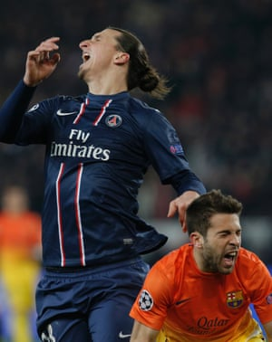 Barcelona's Jordi Alba (R) and Paris Saint Germain's Zlatan Ibrahimovic react during their Champions League quarterfinal soccer match in Paris, France.