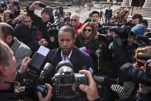 New York State Senator Malcolm Smith is surrounded by media after exiting a U.S. court in White Plains, New York. A high-ranking Democratic New York State senator was arrested on Tuesday and charged with trying to buy a place on the Republican ticket in the city's next mayoral race.