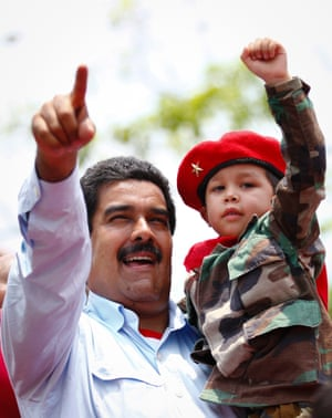 Chavismo 2.0: Venezuela's acting President and presidential candidate Nicolas Maduro carries a child during a campaign rally in the state of Barinas. Venezuelans will vote in the presidential elections on April 14.