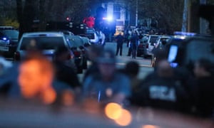 Law enforcement officials surround the second suspected Boston Marathon bomber in Watertown, Massachusetts.