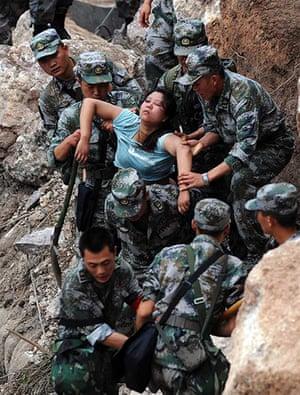 China: Rescuers save an injured woman in Baosheng township