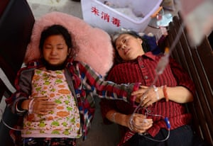 China: Injured people receive treatment at temporary medical tents in Baosheng