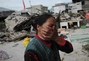 China: A woman reacts as her house is damaged in an earthquake