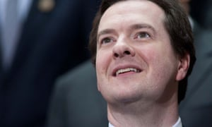 The British chancellor, George Osborne, smiles before a group photo following the G20 meetings