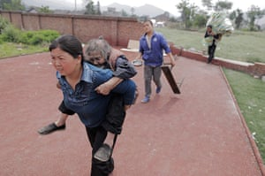 Dan Chung in China: A woman called Mrs Zhang carries her elderly neighbour Tan Xuelan to a temp