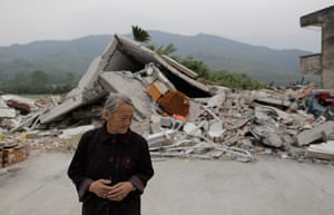Dan Chung in China: Gao Shizhen stands in front of the house where her daughter in law died.