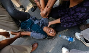 Indian police detain a protester in New Delhi
