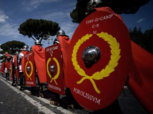 The birth of Rome: Men belonging to historical groups march
