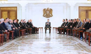 Syria's President Bashar al-Assad meets a delegation of Lebanese politicians as Syrian rebels fired rockets across the border.