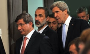US Secretary of State John Kerry and Syrian opposition figure Moaz al-Khatib at the Friends of Syria meeting in Istanbul.