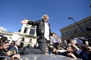 Five-Star Movement's leader Beppe Grillo on the roof of a car in Rome, Italy, 21 April 2013.