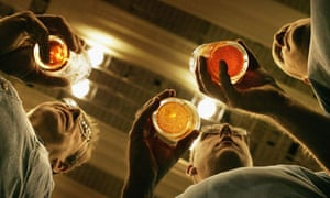 Men drink pints of beer