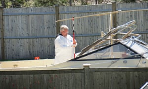 A police forensics team examines a boat in a garden on Franklin Street, where bombing suspect Dzokhar Tsarnaev was discovered.