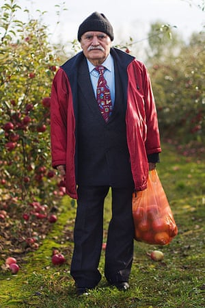 big picture - what ali : man with apples in red coat and suit and hat