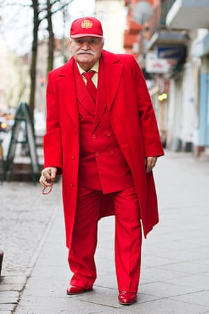 big picture - what ali : man wearing red coat and suit and baseball cap