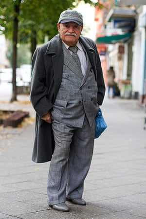 big picture - what ali : man wearing grey suit and coat and baseball cap
