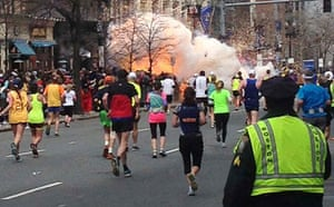 Boston bombings timeline: Runners continue to run towards the finish line as an explosion erupts