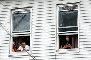 Boston bombings timeline: Residents watch police as they conduct a search for a suspect